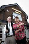 "© Joel Goodman - 07973 332324 . 14/03/2014 . White Horse Pub , Gilda Brook Road , Eccles M30 0DX , UK . Landlady Bernadette "" Babs "" Harvieu (52) (right) and customer of thirty years , Frank Kenny (74) (07706 740908) . Bernadette is unable to renew her contract with Robinsons brewery . Photo credit : Joel Goodman"