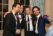 Hamilton co-creators Lin-manuel Miranda, Andy Blankenbuehler, Thomas Kail, and Alex Lacamoire, four of the recipients of the 41st Annual Kennedy Center Honors, pose for a selfie prior to sitting for a group photo following a dinner hosted by United States Deputy Secretary of State John J. Sullivan in their honor at the US Department of State in Washington, D.C. on Saturday, December 1, 2018.  The 2018 honorees are: singer and actress Cher; composer and pianist Philip Glass; Country music entertainer Reba McEntire; and jazz saxophonist and composer Wayne Shorter. This year, the co-creators of Hamilton, writer and actor Lin-Manuel Miranda; director Thomas Kail; choreographer Andy Blankenbuehler; and music director Alex Lacamoire will receive a unique Kennedy Center Honors as trailblazing creators of a transformative work that defies category.<br /> Credit: Ron Sachs / Pool via CNP