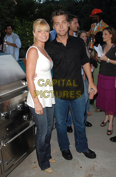 "JAIME PRESSLEY & LANCE BASS.attend the Launch of her ""Adopt-a-School Initiave"" held at RJ Cutler's Estate in The Hollywood Hills, California, USA, August 12, 2006..full length white top jeans jamie black shirt.ref: DVS.www.capitalpictures.com.sales@capitalpictures.com.©Debbie VanStory/Capital Pictures"