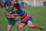 Tau Mata'afa tries to push off Waiuku halfback Graeme Brent. Counties Manukau Premier rugby game between Waiuku & Ardmore Marist played at Waiuku on Saturday May 10th 2008..Ardmore Marist won 27 - 6 after leading 10 - 6 at halftime.