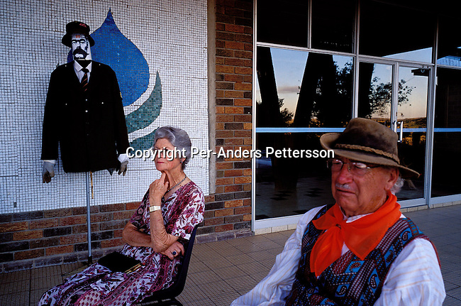 "ORANIA, SOUTH AFRICA - DECEMBER 16: Carel Boshoff (right), the founder and leader of Orania sitting next to an unidentified resident of Orania on December 16, 2003 in Orania, in the Northern Cape province, South Africa. The village commemorated ""the battle of Blood River"", the most important holiday in the Afrikaner culture. Battles raged between Afrikaners and Zulus at Ncome River in Natal in 1838, and God helped the Afrikaners to win the battle. The figure on the left, The British Commander-in chief in South Africa (during the Anglo-Boer war 1901) General Kitchener was used during the day to play games. Sling shoot competitions were held. Prizes were awarded to the person most successful in hitting him. Orania was founded in 1991 and bought by descendants of Hendrik Verwoerd, the architect of Apartheid. It?s run as a private town only accepting whites. About 600 Afrikaners lives in the village where they celebrate their culture and keep traditions alive. They have chosen not to live in today?s South Africa; a country ran by a black government since 1994..(Photo: Per-Anders Pettersson/ iAfrika Photos....."