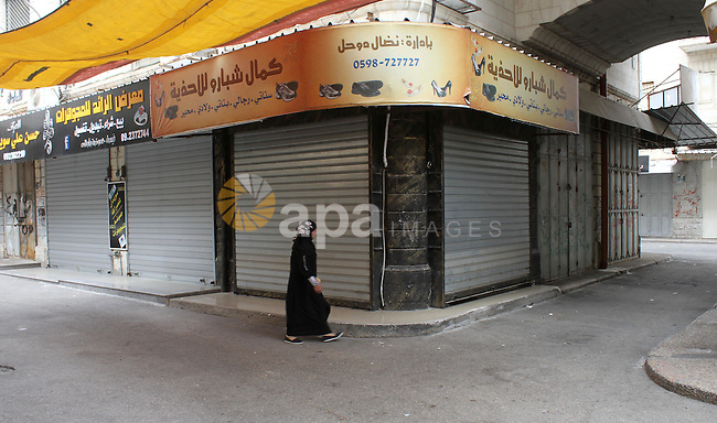 A view into a market street with closed shops as Palestinians walk past in the West Bank city of Nablus 21 July 2014. Shops were shut in the West Bank cites in solidarity with the at least 60 Palestinians who were killed in the neighbourhood of Shejae'yah on 20 July, the deadliest incident in the fighting yet by far, Palestinian Health Ministry spokesman Ashraf al-Qedra said, adding that 210 were injured.A view into a market street with closed shops as Palestinians walk past in the West Bank city of Nablus 21 July 2014. Shops were shut in the West Bank cites in solidarity with the at least 60 Palestinians who were killed in the neighbourhood of Shejae'yah on 20 July, the deadliest incident in the fighting yet by far, Palestinian Health Ministry spokesman Ashraf al-Qedra said, adding that 210 were injured. Photo by Nedal Eshtayah