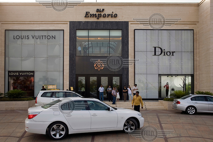 Cars arriving to collect and deposit shoppers at the DLF Emporio in Vasant Kunj, New Delhi. The Emporio is Delhi's most exclusive shopping centre and full of Western and domestic luxury brands and shops featuring Louis Vuitton and Dior.