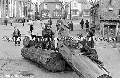 Playing on the logs in the playground, Darell Road Primary School, London.  1973