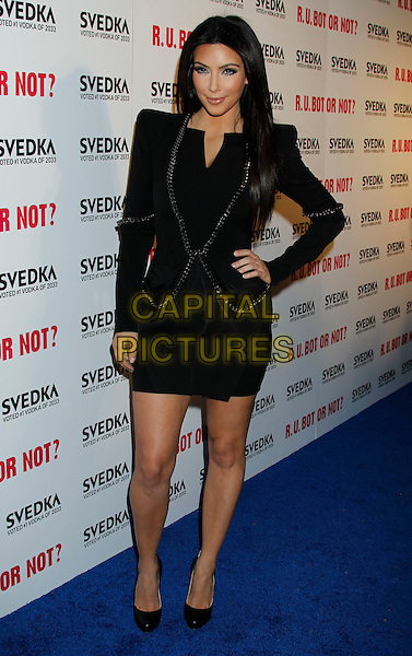 "KIM KARDASHIAN .""Battle Of The Bots"" Sponsored by Svedka Vodka at Wonderland,  Hollywood, California, USA, .22nd May 2010..full length shoulder pads long sleeve sleeved hand on hip shoes dress black make-up chain .CAP/ADM/MJ.©Michael Jade/AdMedia/Capital Pictures."