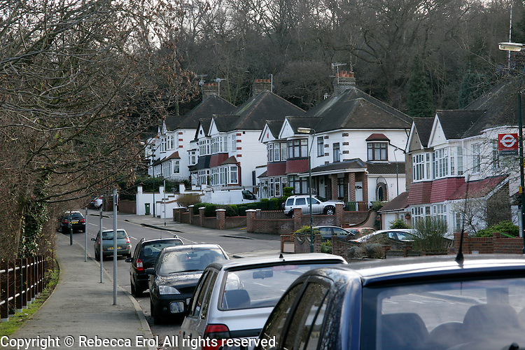 New Road in Abbeywood, southeast London, UK: 1930s suburban housing and Lesnes Abbey woods