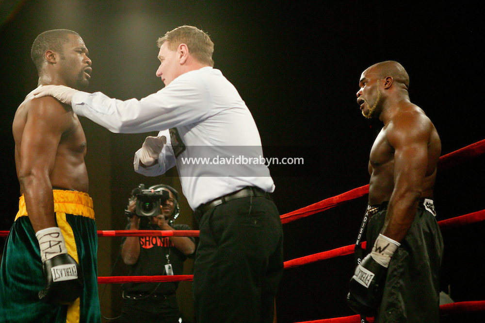 7 January 2006 - New York City, NY - The referee intervenes during the World Cruiserweight Championship unification fight between Frenchman Jean-Marc Mormeck (R) and Jamaican O'Neill Bell (L) at Madison Square Garden in New York City, USA, 7 January 2006. O'Neil Bell won by KO in the 10th round.