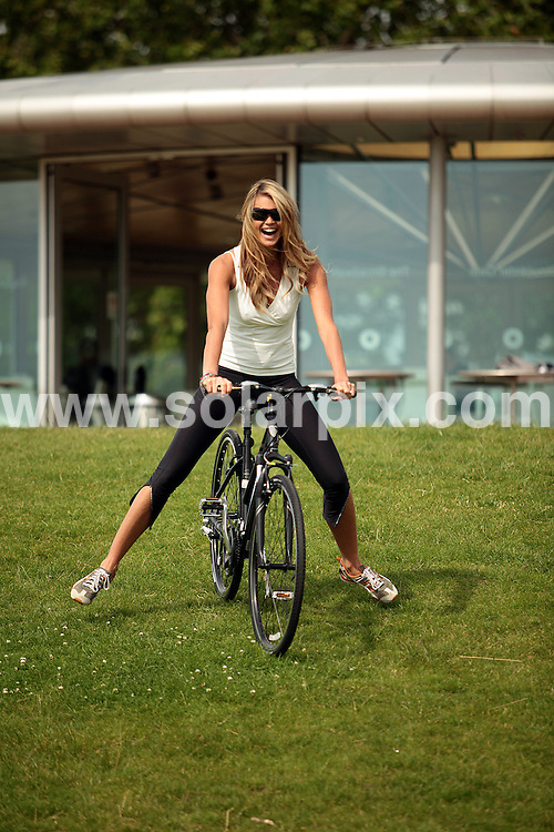 **ALL ROUND PICTURES FROM SOLARPIX.COM**.**WORLDWIDE SYNDICATION RIGHTS**.Model Elle Macpherson, Olympic Gold Medalist Victoria Pendleton and TV presenter Gethin Jones today launched Sky's campaign to get people back on their bikes, through a summer of free Skyride cycling events. Regents Park, London, UK. 17 June 2009 ..This pic: Elle Macpherson ..JOB REF: 9262 MSR DATE: 17_06_2009.**MUST CREDIT SOLARPIX.COM OR DOUBLE FEE WILL BE CHARGED**.**ONLINE USAGE FEE GBP 50.00 PER PICTURE - NOTIFICATION OF USAGE TO PHOTO @ SOLARPIX.COM**.**CALL SOLARPIX : +34 952 811 768 or LOW RATE FROM UK 0844 617 7637**