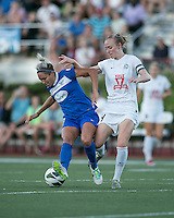 In a National Women's Soccer League Elite (NWSL) match, the Boston Breakers defeated the FC Kansas City, 1-0, at Dilboy Stadium on August 10, 2013.  Boston Breakers forward Kyah Simon (17) protects the ball from FC Kansas City defender Becky Sauerbrunn (4).