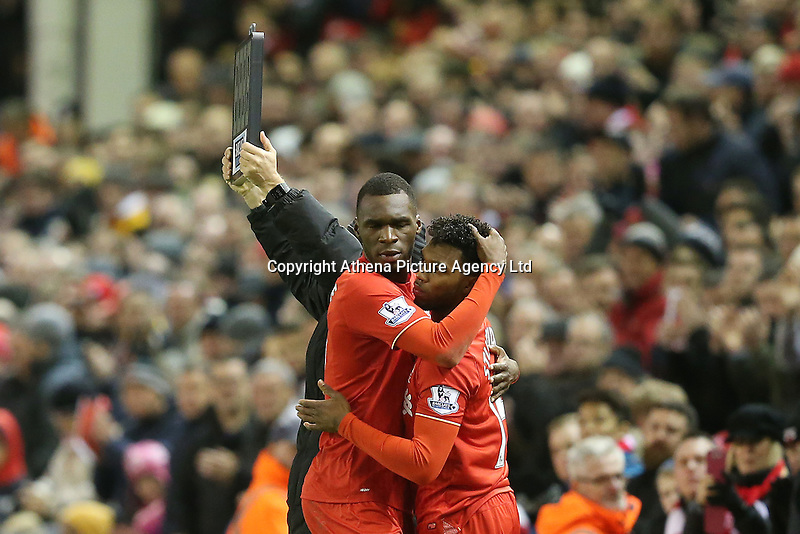 Christian Benteke hugs substitute Daniel Sturridge as he leaves the field during the Barclays Premier League Match between Liverpool and Swansea City played at Anfield, Liverpool on 29th November 2015