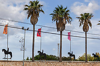 Spain. Balearic Islands. Minorca (Menorca). Son Martorellet. Son Martorellet is a place where the Pure Breed Minorcan horses are breed and trained. The place has daily summer shows for tourists on Menorcan dressage. On the parking's wall, four iron statues of riders and horses, and a symbolic rising horse performing the bot. The aim of the 'bot' is for the horse to stand on its hind legs while keeping its head and shoulders relaxed and without tension. The Menorquín is a breed of horse indigenous to the island and is closely associated with the doma menorquina style of riding. The most valued quality of Menorquín horse is its suitability for the traditional festivals of Menorca. Horses and riders are usually at the centre of local fiesta celebrations. Son Martorellet is located in the centre of the island, which is part of the autonomous community of the Balearic. In Spain, an autonomous community is a first-level political and administrative division, created in accordance with the Spanish constitution of 1978, with the aim of guaranteeing limited autonomy of the nationalities and regions that make up Spain. 11.09.2019 © 2019 Didier Ruef