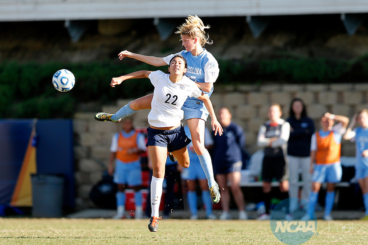 02 DEC 2012:  Katie Bowen (15) of the University of North Carolina and Tani Costa (22) of Penn State University jump for the ball during the Division I Women's Soccer Championship held at Torero Stadium on the University of San Diego campus in San Diego, CA.  North Carolina defeated Penn State 4-1 for the national title.  Jamie Schwaberow/NCAA Photos.