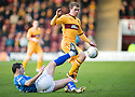 MOTHERWELL'S NICKY LAW IS CHALLENGED BY ST JOHNSTONE'S DAVID MCCRACKEN