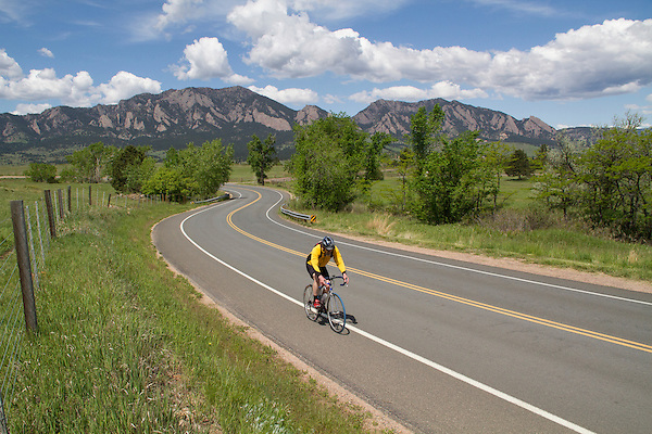 Man cycling on mountain road in Boulder, Colorado .  John leads private photo tours in Boulder and throughout Colorado. Year-round.