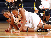 Dec. 18, 2010; Charlottesville, VA, USA; /u23/ goes after the loose ball with UMBC Retrievers guard Kristin Coles (22) during the game at the John Paul Jones Arena.  Mandatory Credit: Andrew Shurtleff