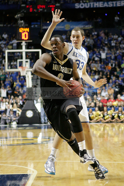 Vanderbilt forward Rod Odom goes toward the basket and escapes defense by Kentucky forward Kyle Wiltjer during the first half of the University of Kentucky men's basketball game vs. Vanderbilt University during the SEC Tournament at Bridgestone Arena in Nashville, Tenn. on Friday, March 15, 2013. UK lost 64-48. Photo by Genevieve Adams | Staff