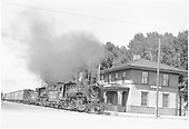 D&amp;RGW #491 and #488 with mixed-gauge freight passing La Jara depot.  A string of standard gauge reefers.<br /> D&amp;RGW  La Jara, CO  Taken by Hanna, John - 7/31/1955