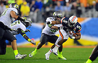 Jan 10, 2011; Glendale, AZ, USA; Auburn Tigers running back Michael Dyer (5) is tackled by Oregon Ducks defenders during the second half of the 2011 BCS National Championship game at University of Phoenix Stadium.  Mandatory Credit: Mark J. Rebilas-