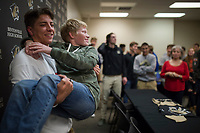NWA Democrat-Gazette/CHARLIE KAIJO Cash Jones takes pictures with friend Jackson Visser, 15 of Bentonville after signing a college letter of intent on Thursday, November 9, 2017 at Bentonville High School in Bentonville. Cash Jones signed his national letter of intent with Campbell University, an NCAA Division I school in North Carolina.