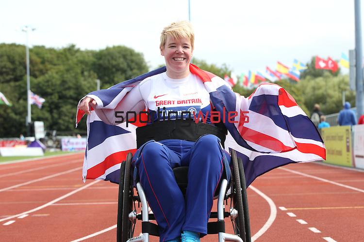 IPC European Athletics Championship 2014<br /> Joanna Butterfield (GBR) celebrates after winning the women's club throw F32/51.<br /> Swansea University<br /> 22.08.14<br /> &copy;Steve Pope-SPORTINGWALES