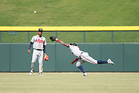 Peoria Javelinas right fielder Izzy Wilson (7), of the Atlanta Braves organization, makes a diving catch in front of Cristian Pache (27) during an Arizona Fall League game against the Mesa Solar Sox at Sloan Park on October 11, 2018 in Mesa, Arizona. Mesa defeated Peoria 10-9. (Zachary Lucy/Four Seam Images)