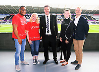 Letou CEO Paul Fox (C) with Sheter Cymru and Sports Wales Charities during the English Premier League soccer match between Swansea City and Manchester United at Liberty Stadium, Swansea, Wales, UK. Saturday 18 August 2017