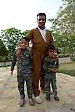 Iraq 2015 <br />Father and sons in a park of Erbil  <br />Irak 2015 <br />Un pere et ses fils dans un parc d'Erbil