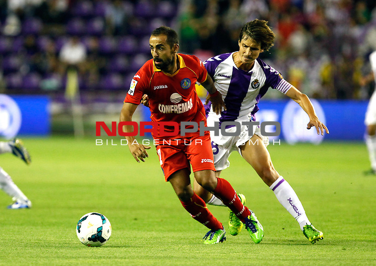 Real Valladolid¬¥s Alvaro Rubio (r) and Getafe's Diego Castro during La Liga match.August 31,2013. Foto © nph / Victor Blanco)