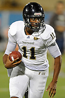 30 March 2012:  FIU's Akil Dan-Fodio (11) carries the ball at the FIU Football Spring Game at University Park Stadium in Miami, Florida.