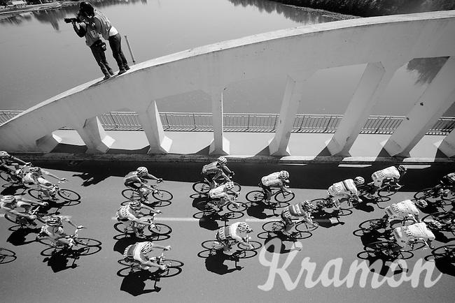 peloton over the Saône River Bridge<br /> <br /> 2014 Tour de France<br /> stage 12: Bourg-en-Bresse - Saint-Etiènne (185km)
