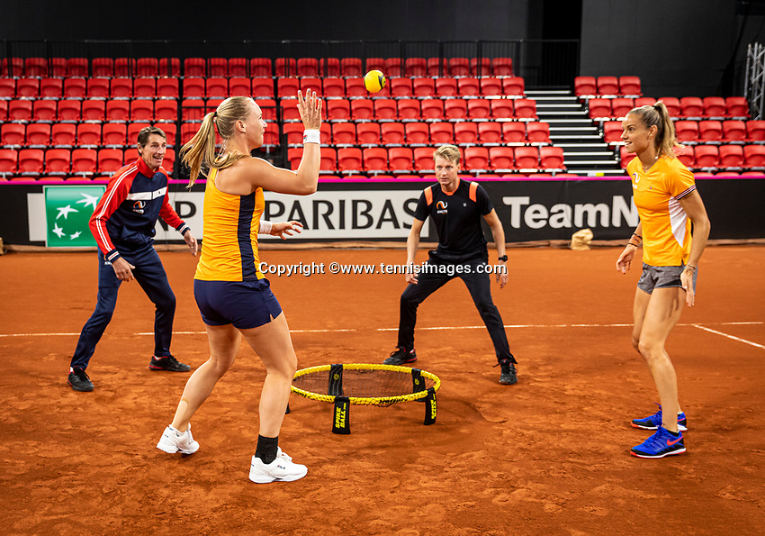 The Hague, The Netherlands, Februari 4, 2020,  Sportcampus , FedCup  Netherlands - Balarus, Dutch team practise, playing spike ball, ltr: Captain Paul Haarhuis, Kiki Bertens, coach Roel Oostdam  and Arantxa Rus.<br /> Photo: Tennisimages/Henk Koster