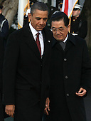 United States President Barack Obama (R) walks with President Hu Jintao during a State arrival ceremony on the South Lawn of the White House, Wednesday, January 19, 2011 in Washington, DC. Obama and Hu are scheduled to meet in the Oval Office later in the day, hold a joint press conference and attend a State dinner.  .Credit: Mark Wilson / Pool via CNP