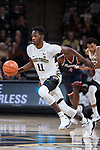Melo Eggleston (11) of the Wake Forest Demon Deacons pushes the ball up the court during second half action against the Richmond Spiders at the LJVM Coliseum on December 2, 2017 in Winston-Salem, North Carolina.  The Demon Deacons defeated the Spiders 82-53.  (Brian Westerholt/Sports On Film)