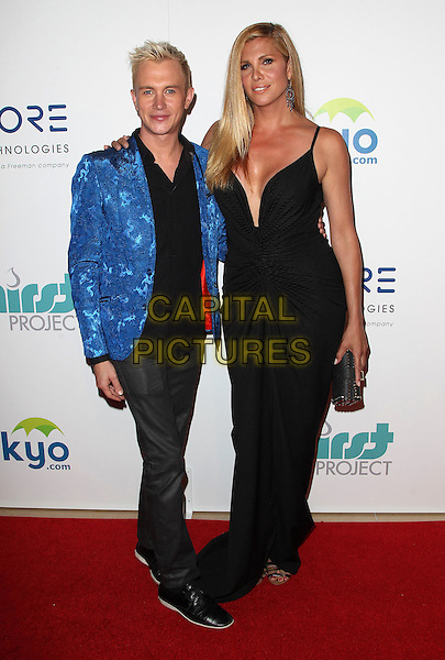 24 June 2014 - Beverly Hills, California - Andrew Gruver, Candis Cayne. 5th Annual Thirst Project Gala held at the Beverly Hilton Hotel. <br /> CAP/ADM/FS<br /> &copy;Faye Sadou/AdMedia/Capital Pictures