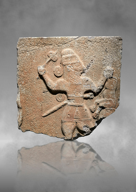 Hittite monumental relief sculpture of a man with an axe in one hand about to use it to kill a lion he is holding updide down in his other hand. Late Hittite Period - 900-700 BC. Adana Archaeology Museum, Turkey. Against a grey art background