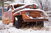 Old trucks covered in snow.