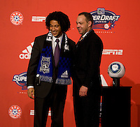 MLS executive vice president Todd Durbin welcomes Justin Morrow of Notre Dame to the stage as the 28th  overall pick of  the MLS Superdraft by the San Jose Earthquakes at the Pennsylvania Convention Center in Philadelphia, PA.