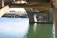 Texans enjoy canoeing and kyaking under the bridges on town lake in austin.