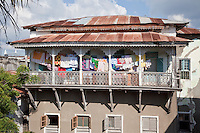 Zanzibar, Tanzania.  Stone Town House, South Asian Style  Balcony Railing with Laundry.