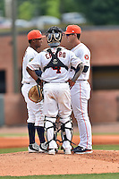 Greeneville Astros starting pitcher Carlos Hiraldo (15) catcher Ruben Castro (4) and pitching coach Bill Murphy (8) discuss the situation during a game against the Kingsport Mets at Pioneer Park on July 3, 2016 in Greeneville, Tennessee. The Mets defeated the Astros 11-0. (Tony Farlow/Four Seam Images)