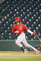 Jose A. Rodriguez (14) of the AZL Angels bats during a game against the AZL Giants at Tempe Diablo Stadium on July 6, 2015 in Tempe, Arizona. Angels defeated the Giants, 3-1. (Larry Goren/Four Seam Images)