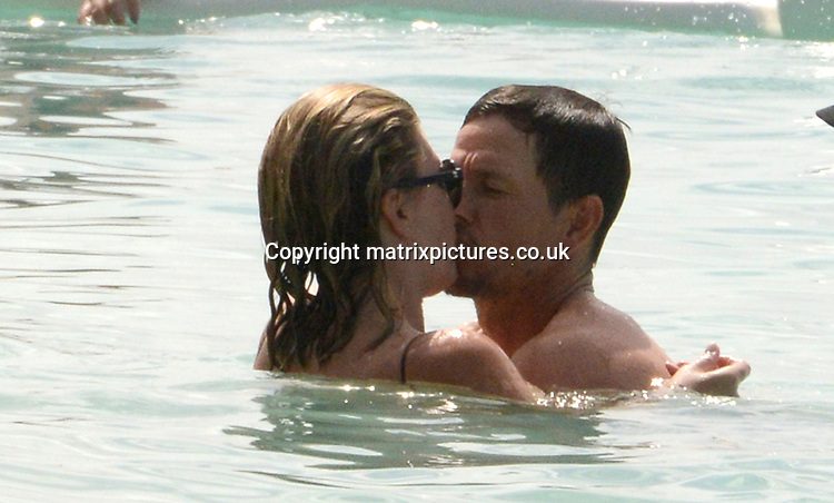 PICTURE: MATRIXPICTURES.CO.UK<br /> PLEASE CREDIT ALL USES<br /> <br /> WORLD RIGHTS<br /> <br /> American actor Mark Wahlberg is pictured on a Christmas break in Barbados.<br /> <br /> The 46-year-old Daddy's Home star is seen mixing with locals and holiday-makers on the beach before taking his son for a jet ski ride.<br /> <br /> DECEMBER 30th 2017<br /> <br /> REF: HMC 172931