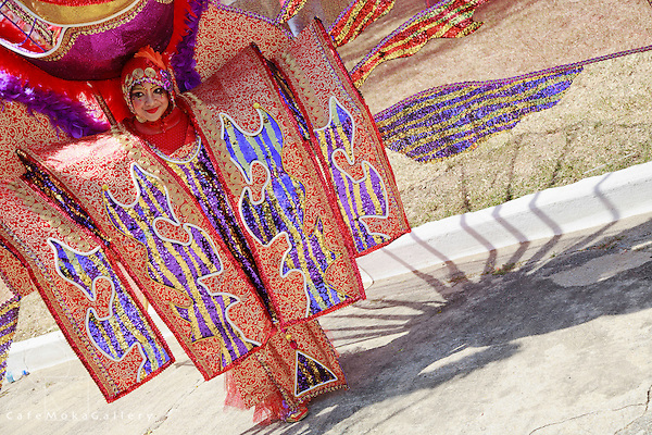 """Junior Carnival - La Diabla, Spoilt Rotten Kids, """"Colours of the Wind"""", Megan Nunes, detail of costume and smiling beautiful face and shadow"""