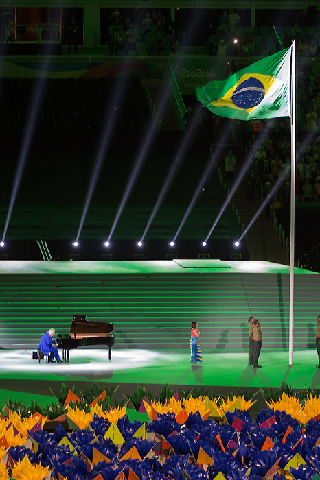 RIO DE JANEIRO - 7/9/2016:  Maestro Joao Carlos Martins plays the Brazilian national anthem as the flag is raised during Opening Ceremonies in Maracana at the Rio 2016 Paralympic Games. (Photo by Matthew Murnaghan/Canadian Paralympic Committee
