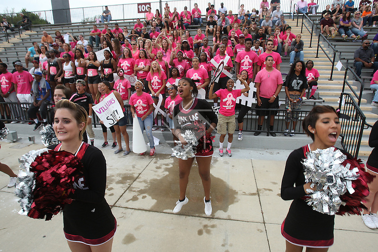 Lindenwood University - Belleville cheerleaders and students yell their support for the Lynx players during the first half of their Homecoming Game against the Menlo College Oaks.