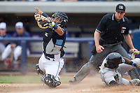 West Michigan Whitecaps catcher Arvicent Perez (13) reaches Dayton Dragons baserunner Shed Long (5) as he slides into home on April 24, 2016 at Fifth Third Ballpark in Comstock, Michigan. Dayton defeated West Michigan 4-3. (Andrew Woolley/Four Seam Images)