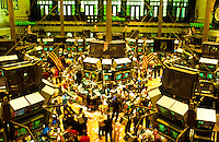 The Stock Exchange with computer screens in New York City, USA