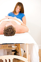Series of a young couple getting massages by therapists.  Together, as well as separate.  Bright and clean.