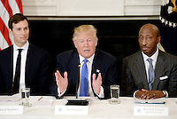 United States President Donald Trump (C) speaks as Jared Kushner (L) , White House Senior Adviser, Kenneth Frazier (R), Chairman and CEO, Merck look on during a  listening session with manufacturing CEOs  in the State Dining Room  of the White House on February 23, 2017 in Washington, DC. Photo Credit: Olivier Douliery/CNP/AdMedia
