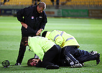 Security subdue a pitch invader after the match has finished during 2nd Twenty20 cricket match match between New Zealand Black Caps and West Indies at Westpac Stadium, Wellington, New Zealand on Friday, 27 February 2009. Photo: Dave Lintott / lintottphoto.co.nz